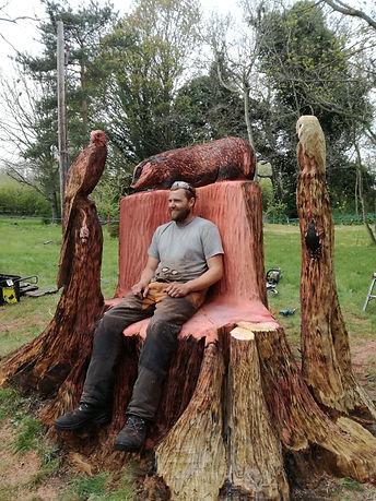Chainsaw Carver Arnie Barton enjoying a rest on his new creation
