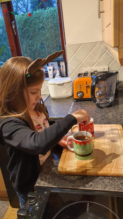 Home Schooling - learning to do things safely such as making a cup of tea. (Polly puts the kettle on