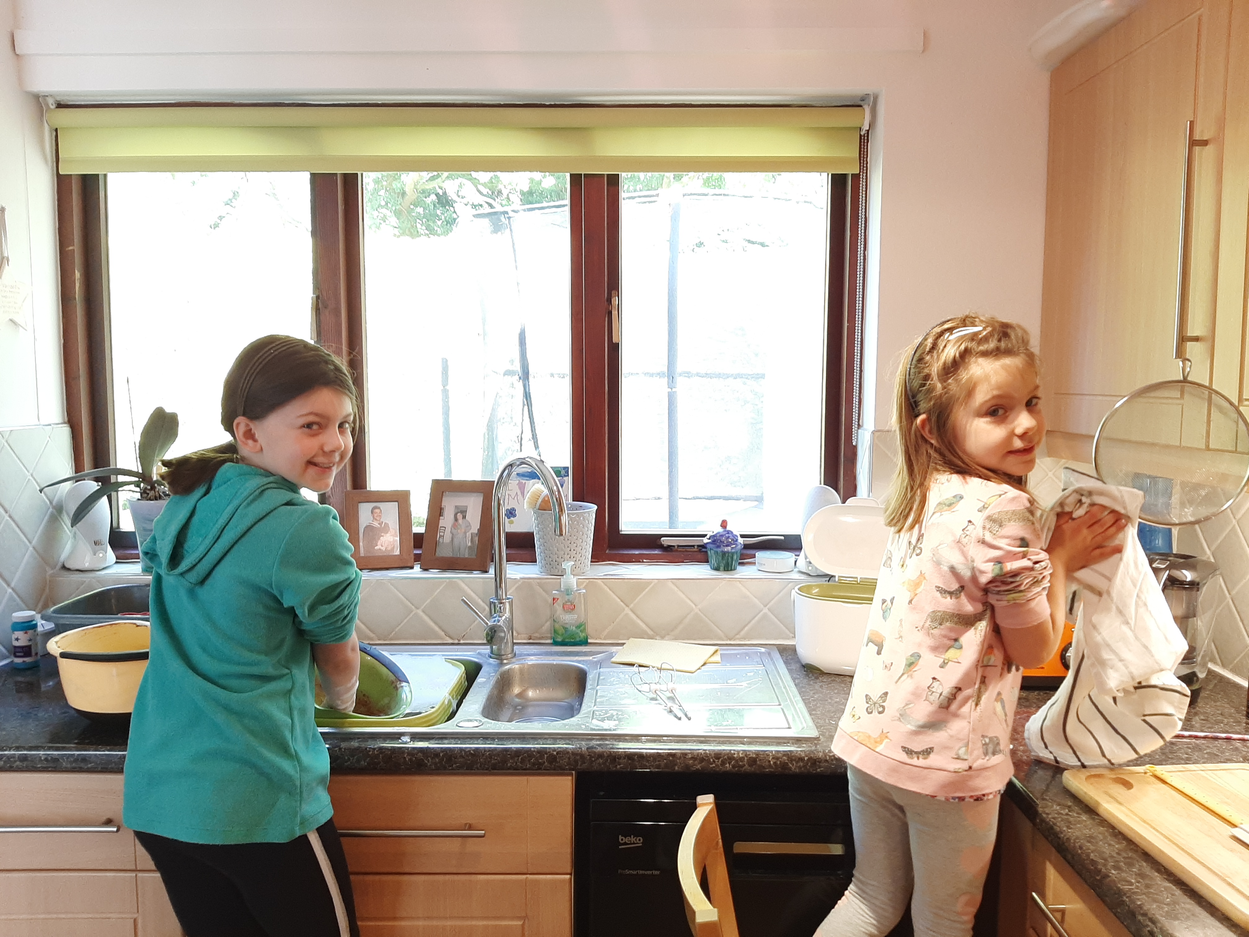 Home Schooling - learning life skills such as washing up.