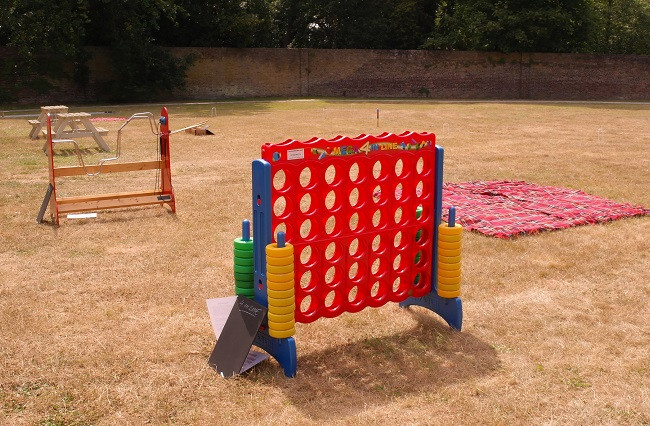 Connect 4, Buzz Bar and Croquet at Fulham Palace London, together with vintage-style picnic benches and picnic rugs
