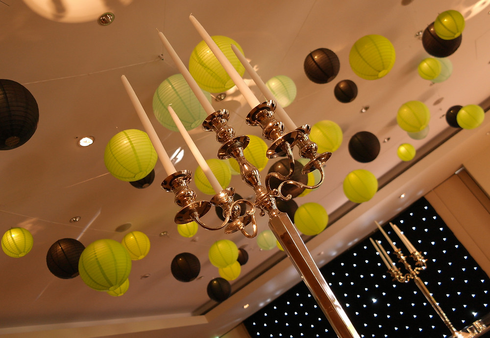 Hanging lanterns in green and black at the Hurlingham Club for a corporate christmas party