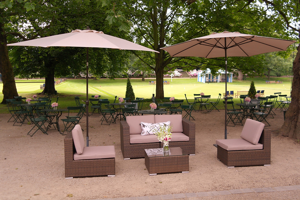 Rattan garden furniture and parasols at The Hurlingham Club London