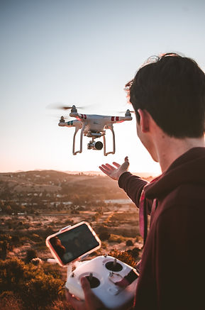 man-holding-quadcopter-remote-3072101.jp