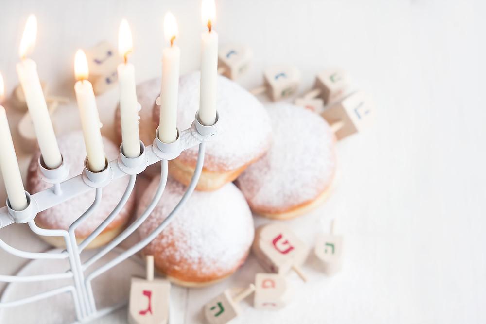 Hanukkah candles represent abundance with Peninsula Family Coaching