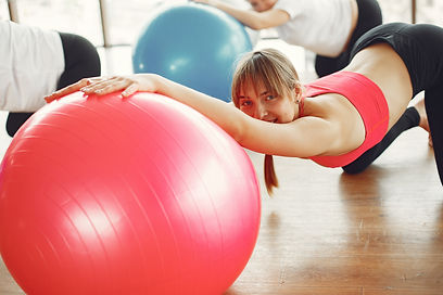 cheerful-female-instructor-with-red-fit-