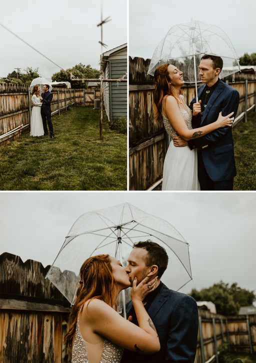 Andy and Nicole standing with clear umbrella in the rain for bride and groom portraits.