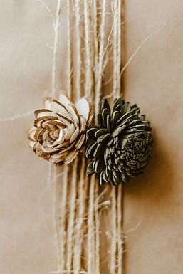 Gift wrap with kraft paper, twine, and sola wood flowers.
