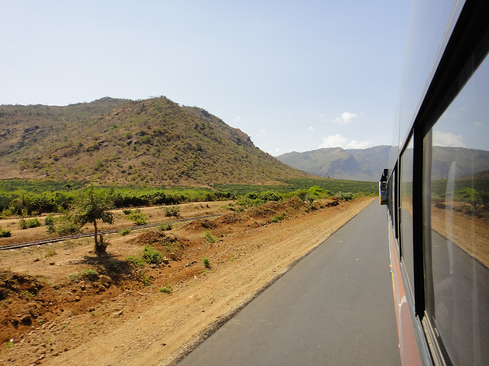 view of the Usambara Mountains from the window of a bus in Tanzania