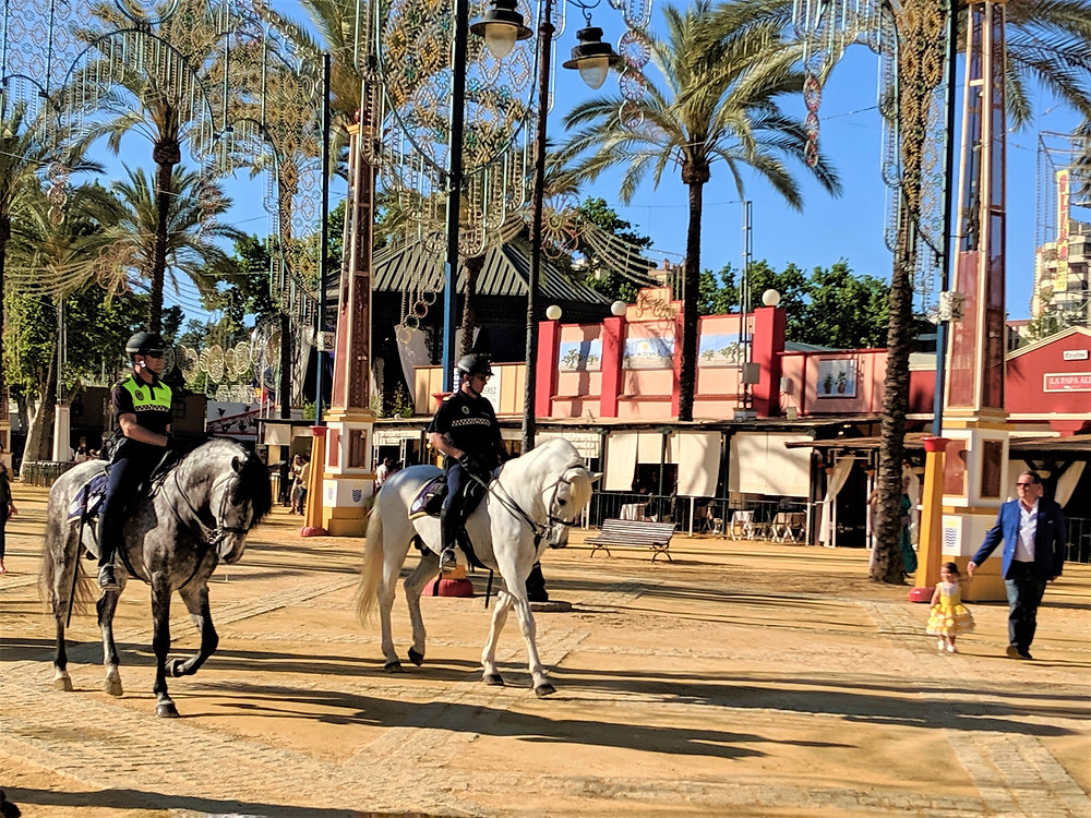 police on horseback during the Ferria del Caballo in Jerez de la Frontera, Spain