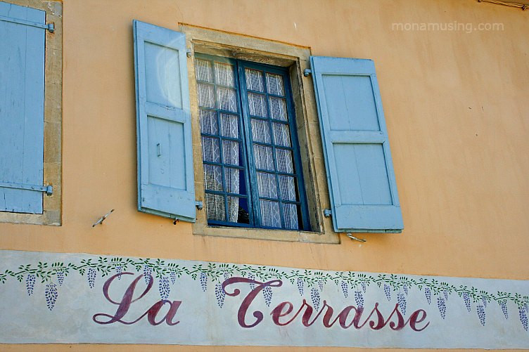 painted shutters at a restaurant in the Averyon region of southern France