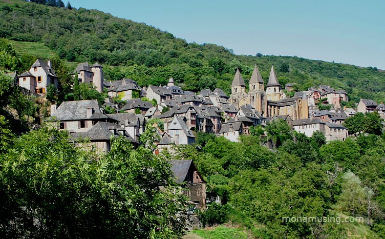 the village of Conques, built into a hillside in southern France