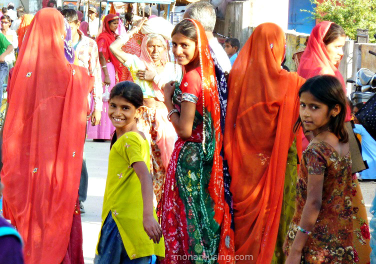 women and girls in colourful saris on the streets of Jojawar, a village in Rajasthan, India