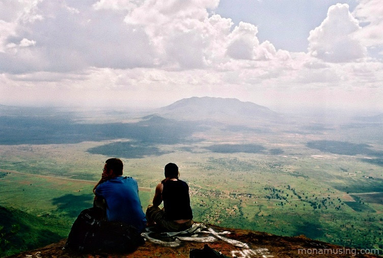 hikers looking out over a valley from Irente Viewpoint in Tanzania's Usambara Mountains