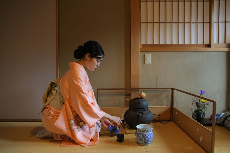 woman in kimono performing tea ceremony