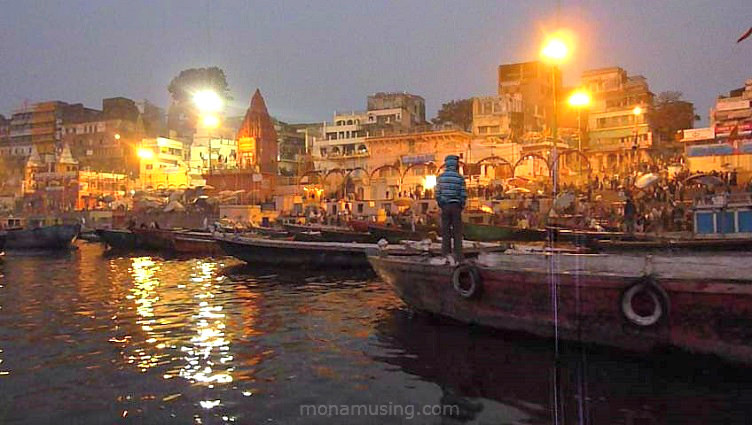 boats moored by the Veranasi ghats on the Ganges River just before sunrise