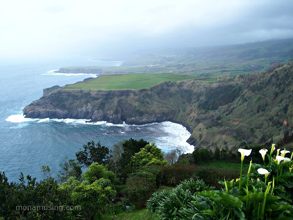 cloudy weather against the seaside cliffs and green landscapes on Sao Miguel Island in the Azores