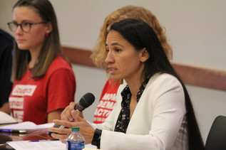 """U.S. Rep. Sharice Davids (D-KS-04) gives remarks at a gun violence roundtable in Overland Park on the importance of passing """"common sense"""" bills and the urgent problem with the Senate's reluctance to take a vote on bills like House Bill 8, which would require all gun sellers to conduct background checks on all gun buyers. Photo by Ben Henschel."""