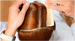 getty_rf_photo_of_hairstylist_sectioning_hair_with_comb.jpg