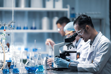 young-scientist-looking-through-microsco