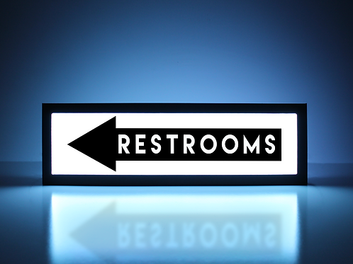 Restrooms This Way (Left) Sign