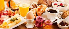 Breakfast feast with egg, meat, bread, c