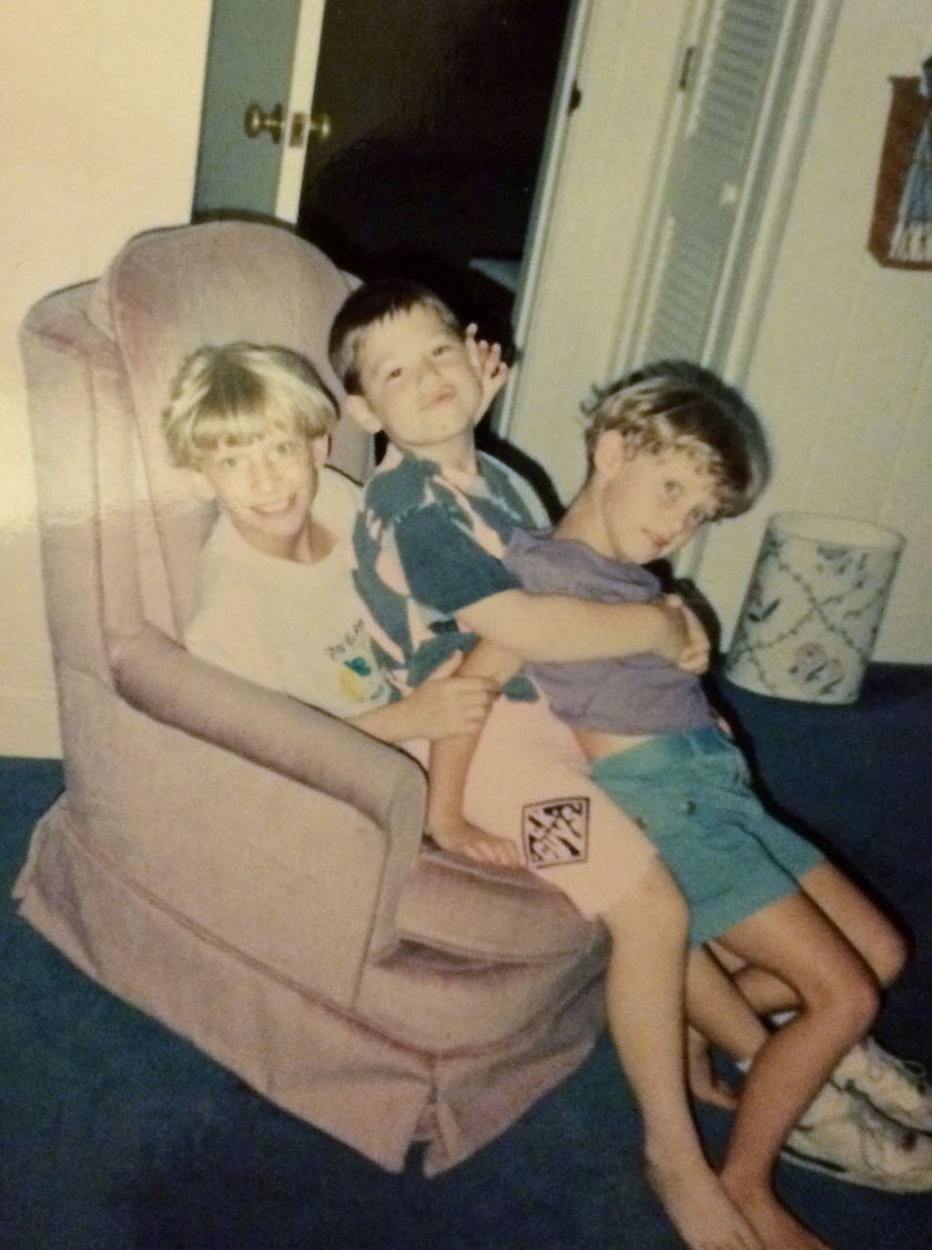 My sister Katie, my cousin Adam, and my in the pink chair at my grandparent's house.