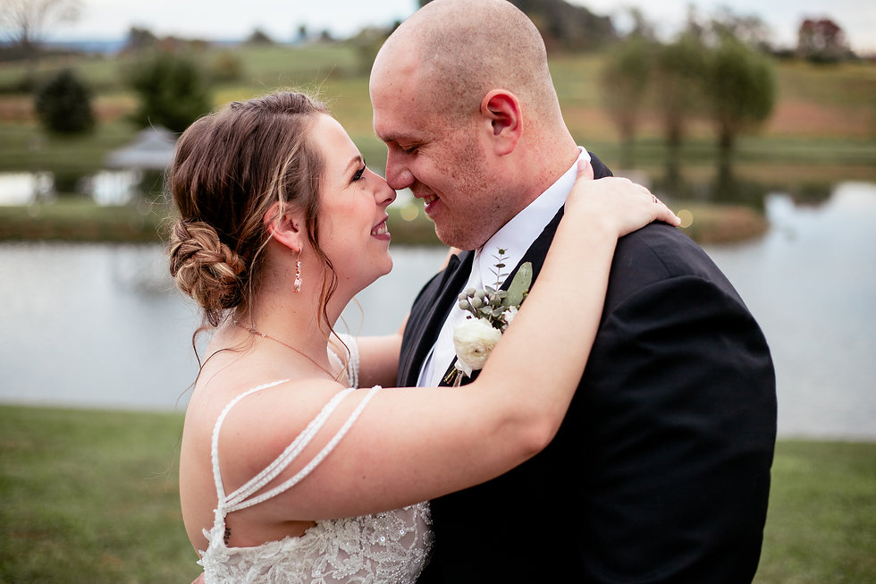 Bride and groom touching noses at Lakeside Venues in McClellandtown, PA