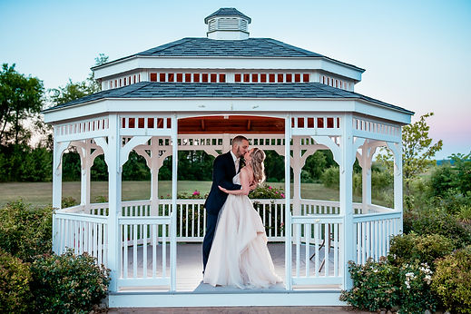 Bride and groom kissing in gazebo at Nicassio Fields venue in Harrison City, PA