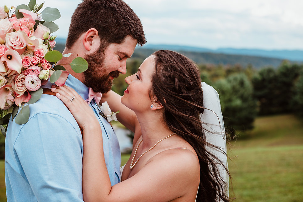 Close portrait of bride and groom gazing into each others eyes at Dream Mountain Ranch in Albright, WV