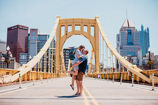 Couple kissing on the Roberto Clemente Bridge in Pittsburgh, PA