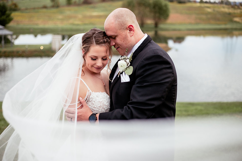 Groom embracing bride at Lakeside Venues