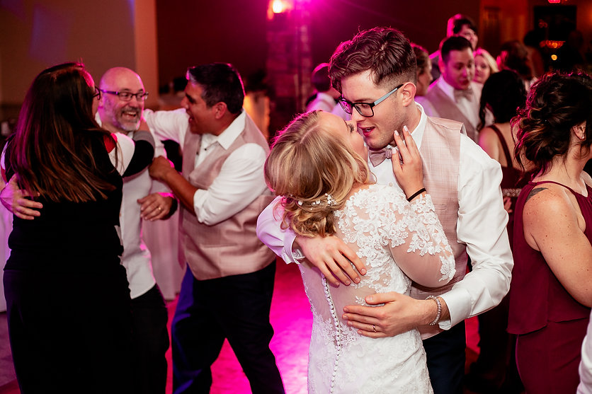Bride and groom embracing on the dance floor of Celebrations Bar & Grill in Imperial, PA