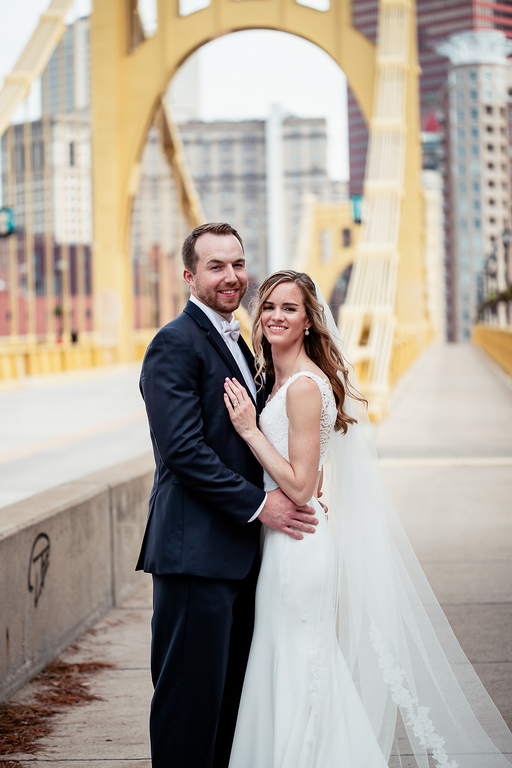 Portrait of bride and groom near bridge in downtown Pittsburgh, PA