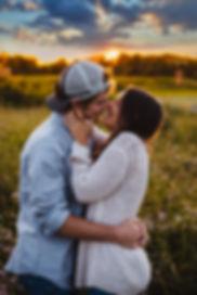 Joyful Kiss at Sunset