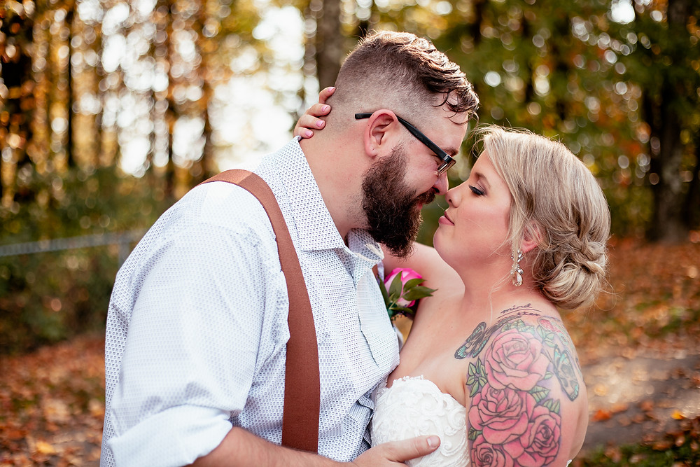 Bride and groom nuzzle noses at wedding at Monroeville Community Park, PA.
