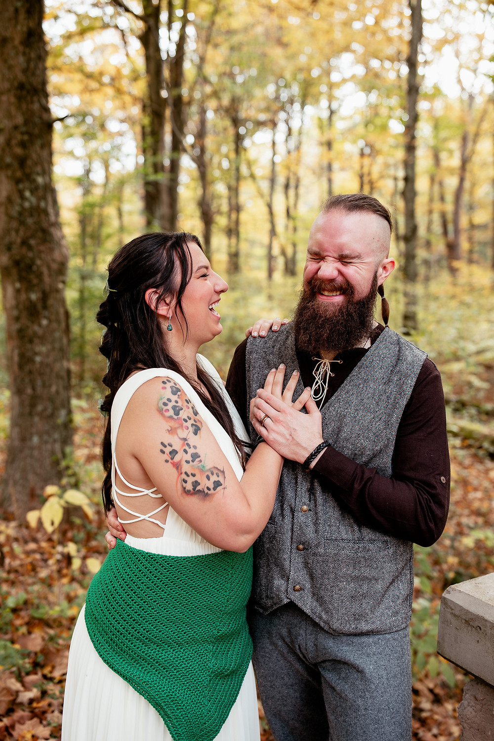 Bride and groom laughing at their elopement in Raccoon Creek State Park, Hookstown, PA