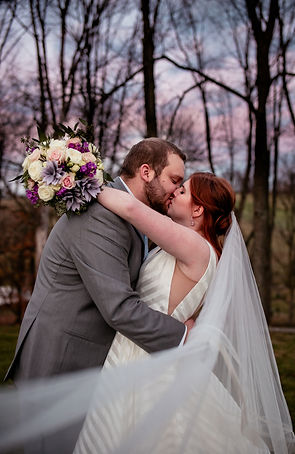 Kissing bride and groom with purple sunset at Greendance Winery in Mt. Pleasant, PA