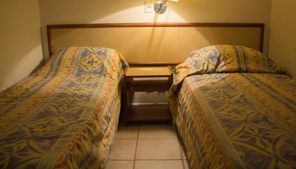 Disposição camas duplo solteiro*