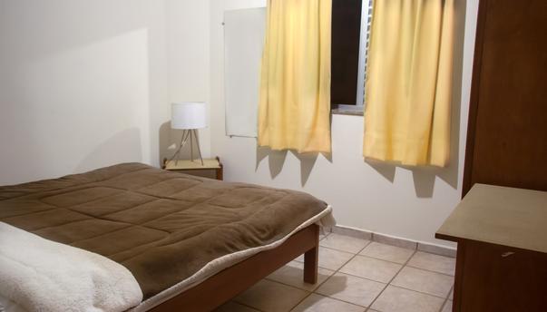 quarto flat padrão visao porta-janela 27