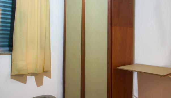 quarto flat padrão detalhe canto armario