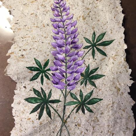 Lupine flower on pineapple paper