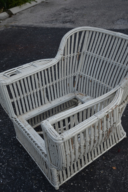 antique stick wicker club with drink and magazine holders