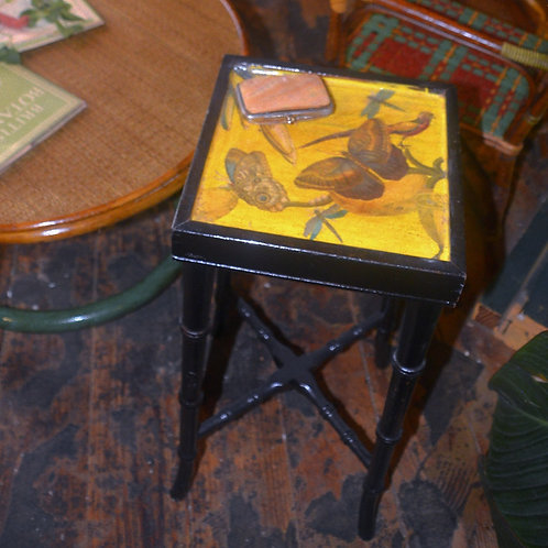 Decoupaged drinks table with faux bamboo legs
