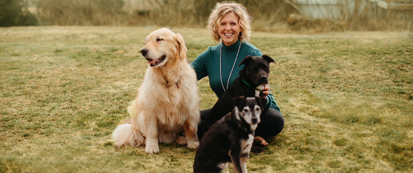 Amy Hagan with dogs on the grass