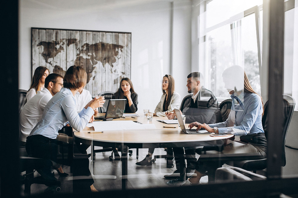 Group of people working around table conference room