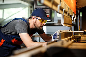 portrait-worker-near-metalworking-machin