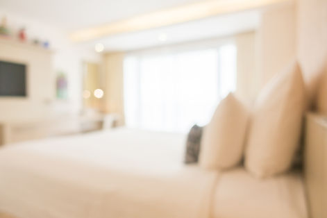 blurred-double-bed-with-furnitures.jpg
