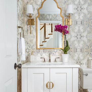 Modern powder room with gold accents and wallpaper designed by Erika Jayne Design, a Maryland based interior design firm serving the Washington, DC area.