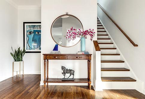 A modern chic foyer designed by Erika Jayne Design a Maryland based interior design firm serving the Washington, DC area.