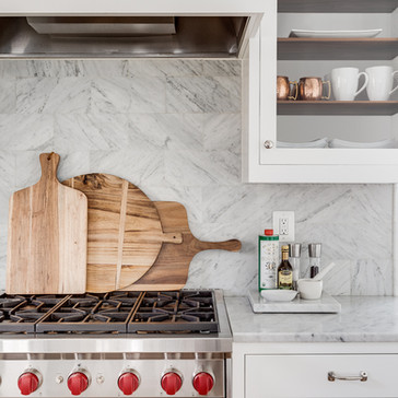 A modern light and bright kitchen with wood accents designed by Erika Jayne Design, a Maryland based interior design firm serving the Washington, DC area.